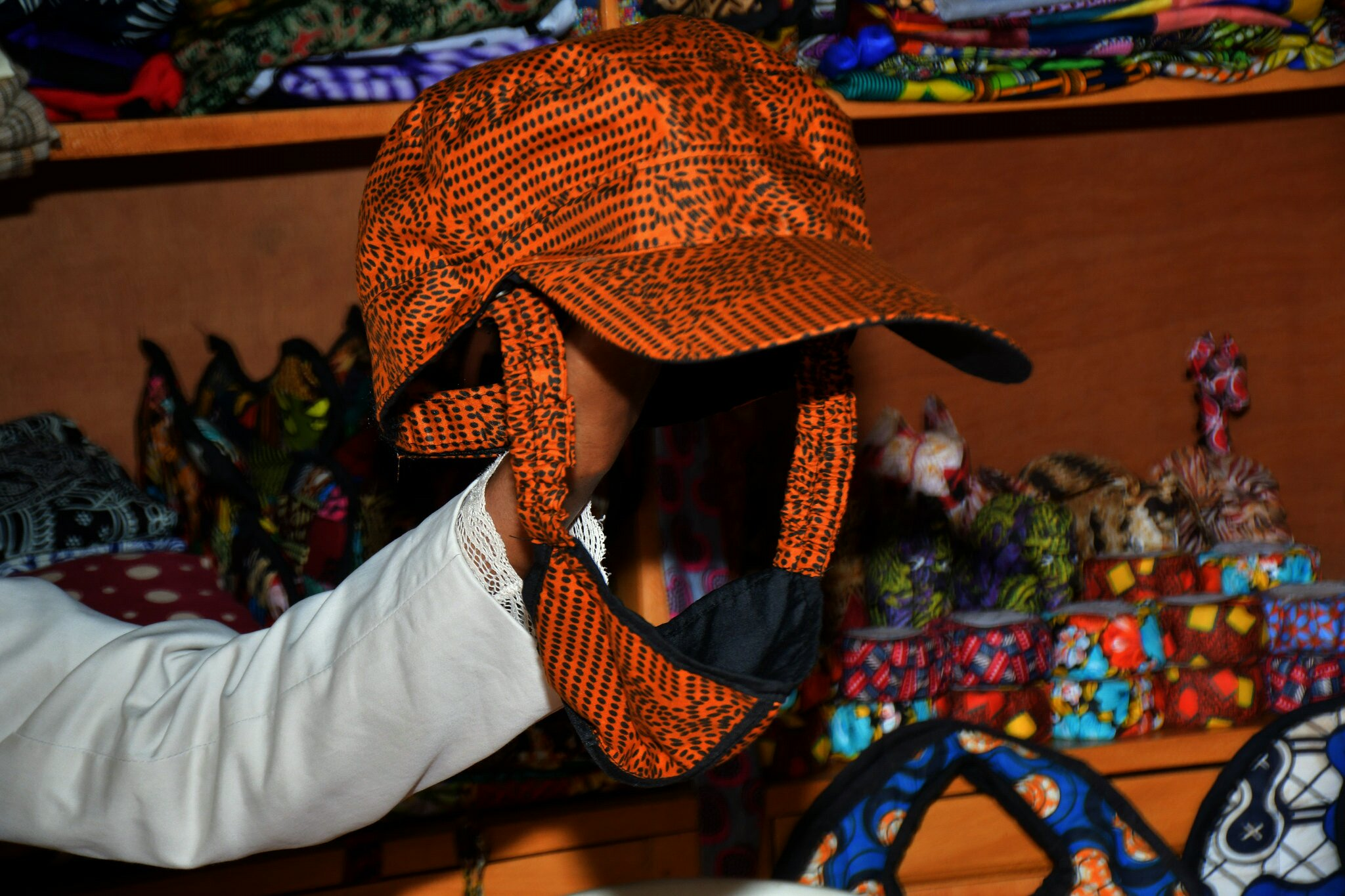 This kitenge cap comes with a detachable face mask